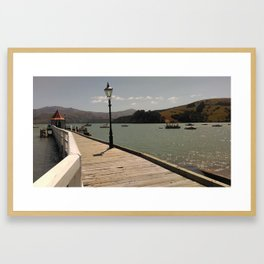 akaroa walkway into lake in french town in new zealand Framed Art Print