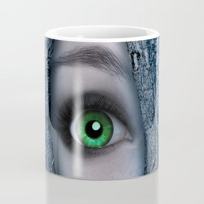 Big green eye in a blue tree Coffee Mug