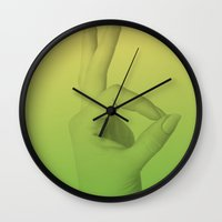 kim sy ok Wall Clocks featuring OK by James Matthews
