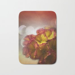 primroses with bokeh Bath Mat