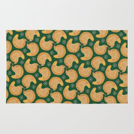 Yellow hen pattern on green Rug