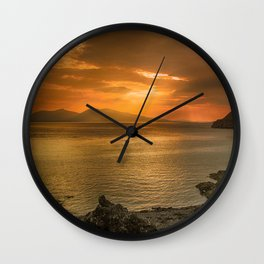 Sunset over Lismore Island of the shores of Oban in the west of Scotland. Wall Clock