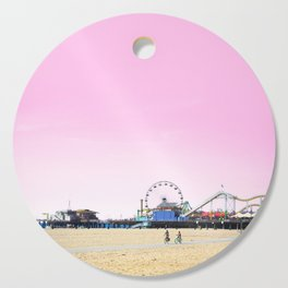 Santa Monica Pier with Ferries Wheel and Roller Coaster Against a Pink Sky Cutting Board