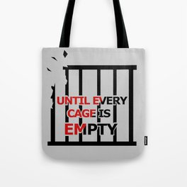 Until Every Cage Is Empty. Tote Bag