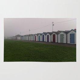 Preston Beach Huts On A Foggy Morning Rug