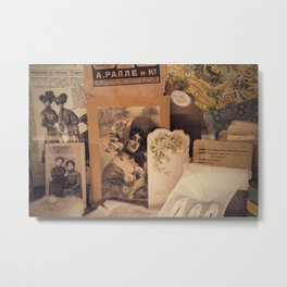 Nostalgic vintage background with yellowed sentimental portraits of glamour ladies, old post card, lace glove, feminine accessories,advertisement and russian 1900-s newspapers.Moscow,Russia,Jan 2021 Metal Print