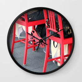 Sitting Cross Legged On The Red Chair Wall Clock