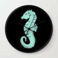 sea horse Wall Clocks featuring SEA HORSE by Matthew Taylor Wilson