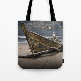 Gulls Flying over a Shipwrecked Wooden Boat Tote Bag