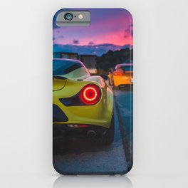 Led tail lights of green and orange sports cars at sunset iPhone Case
