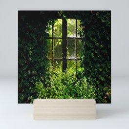 Green idyllic overgrown cottage garden window Mini Art Print