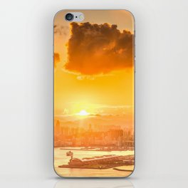 warm color tone orange sunset over hong kong urban city skyline at seafront iPhone Skin