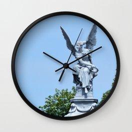 Angel and blue skies Wall Clock
