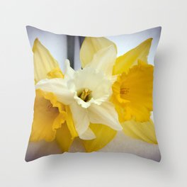 Daffodils resting in the snow after a late London snowstorm in March Throw Pillow