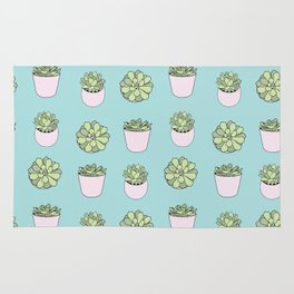 Green suculents in pink flowerpots on mint background Rug