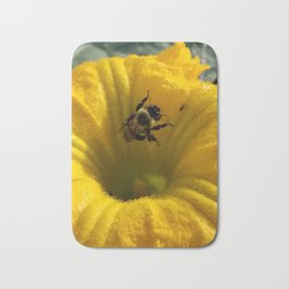 Pollen collecting in a pumpkin blossom Bath Mat