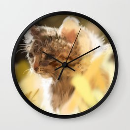 Kitty in a field on a warm spring day Wall Clock