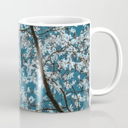 Beautiful white flowers all over the trees with clear blue sky in the background Coffee Mug