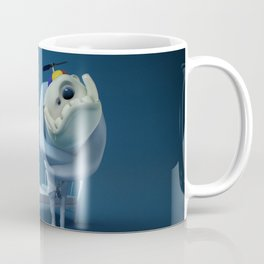 Crazy monster, in a straitjacket, with his bed. Coffee Mug
