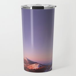 Under a blue sky Travel Mug