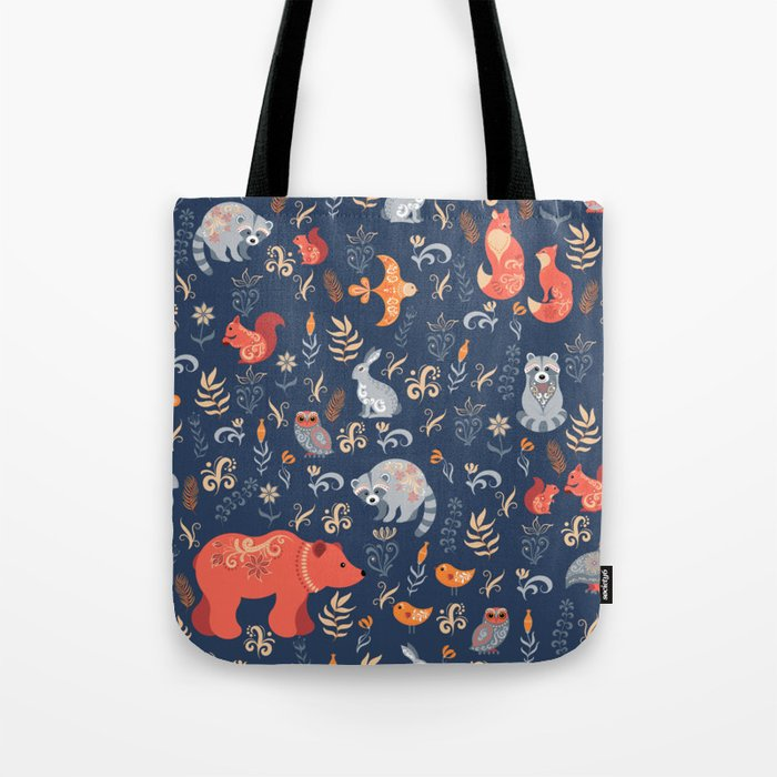 Fairy-tale forest. Fox, bear, raccoon, owls, rabbits, flowers and herbs on a blue background. Seamle Tote Bag
