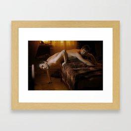 Animal on the bed Framed Art Print