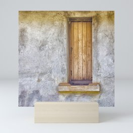 Old shuttered window Mini Art Print
