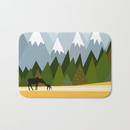 Woodland snowy mountain tops trees and mother moose and baby Bath Mat