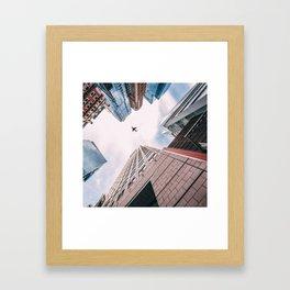 Plane Over New York City Framed Art Print