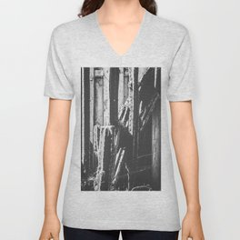 cactus with wooden fence background in black and white Unisex V-Neck