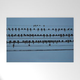 birds on a wire feeling blue Welcome Mat