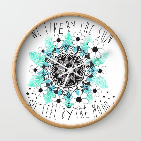 We live by the sun We feel by the moon Wall Clock by Sara Eshak
