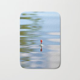 Fishing float on the water Bath Mat