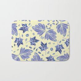 Autumn leaves in light yellow and blue Bath Mat