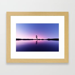 female runner in seashore landscape Framed Art Print