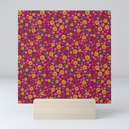 Scattered yellow and pink flowers on a purple background. Mini Art Print