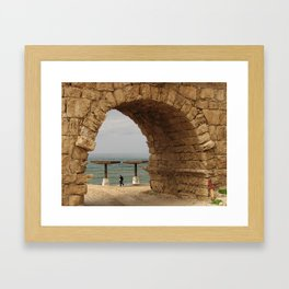 Fisherman through Aqueduct Framed Art Print