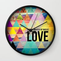 "pocketfuel Wall Clocks featuring 1 Corinthians 13:13 ""And the greatest of these is Love"" by Pocket Fuel"