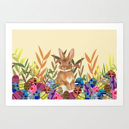 Bunny in garden with colored Easter eggs Art Print