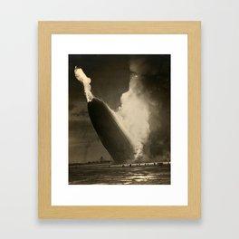 The Hindenburg hits the ground in flames in Lakehurst, N.J. Framed Art Print
