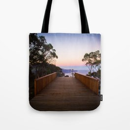 Sitting on the dock of the cliff Tote Bag