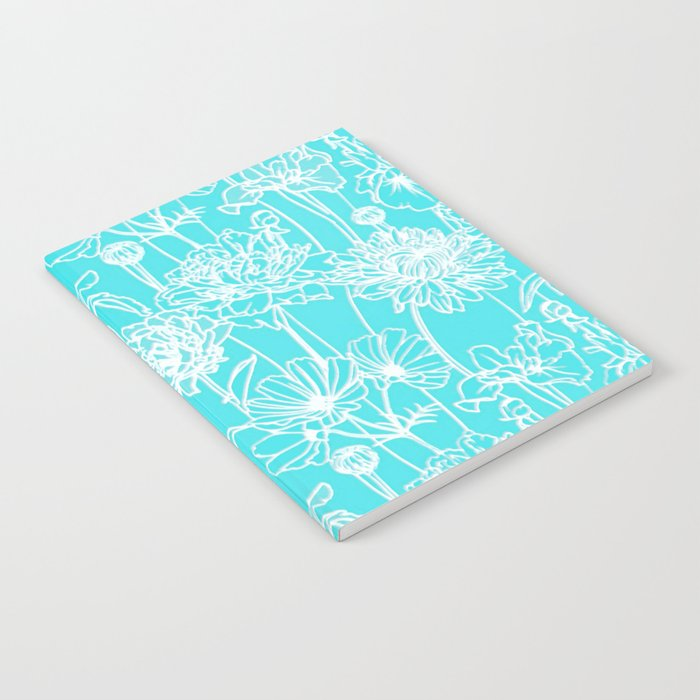 white flowers on turquoise Notebook