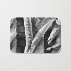 Large Black and White Curled Leaves and Geometric Tile Bath Mat
