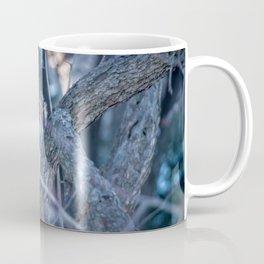 Squirrel eating on sunset during winter Coffee Mug