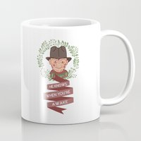 freddy krueger Mugs featuring Freddy Krueger Christmas by Big Purple Glasses
