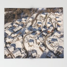 mountain village from the sky Throw Blanket
