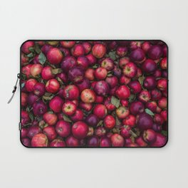 A photograph of a bunch of red apples freshly picked. Laptop Sleeve