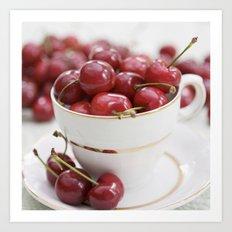 Cherries in a teacup Art Print