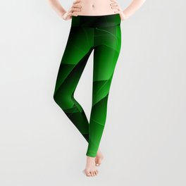 Repetitive overlapping sheets of pastel green paper triangles. Leggings