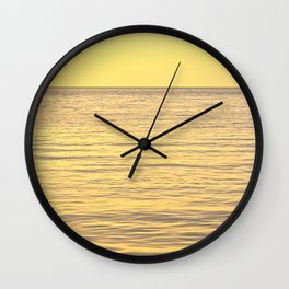 Sunset in the sea Wall Clock